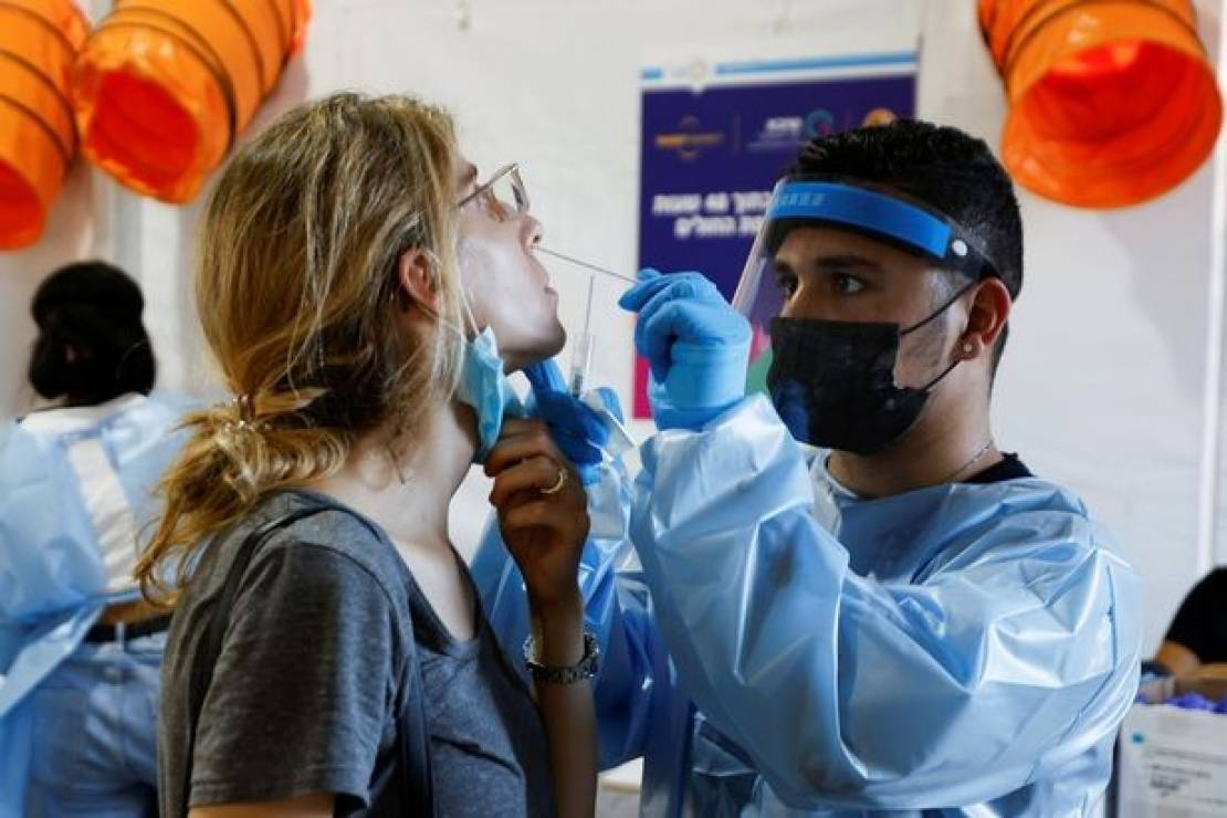 2_People-wait-to-be-tested-at-a-temporary-coronavirus-disease-COVID-19-testing-centre-in-Tel-Aviv